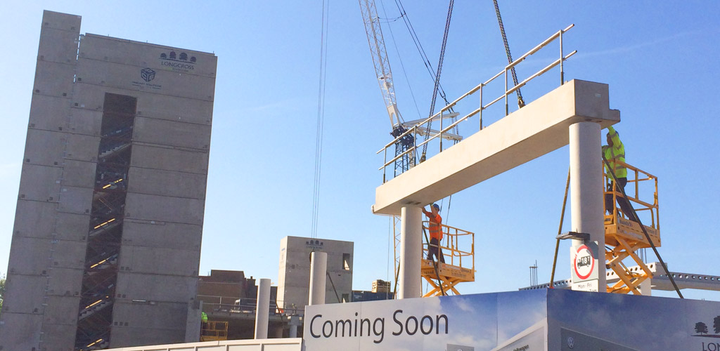 The design features a special modular box system for the three precast cores