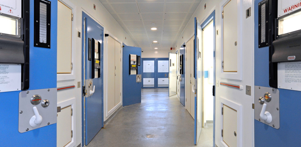 Detention wings each with 10 cells and shower facilities