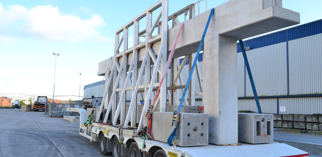 Precast column and beam unit arriving on site