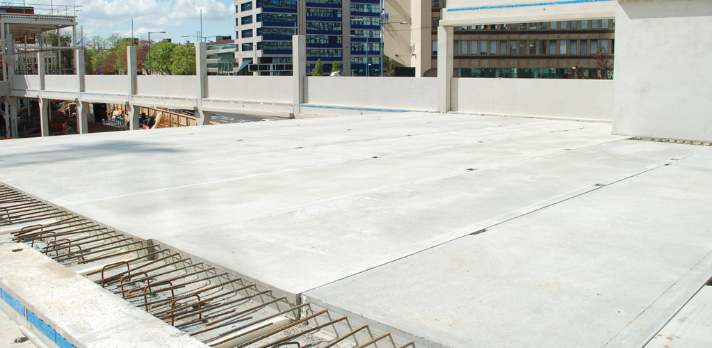GT flooring units can be used with a full precast concrete frame or with precast columns and 400mm-deep in-situ post-tensioned beams