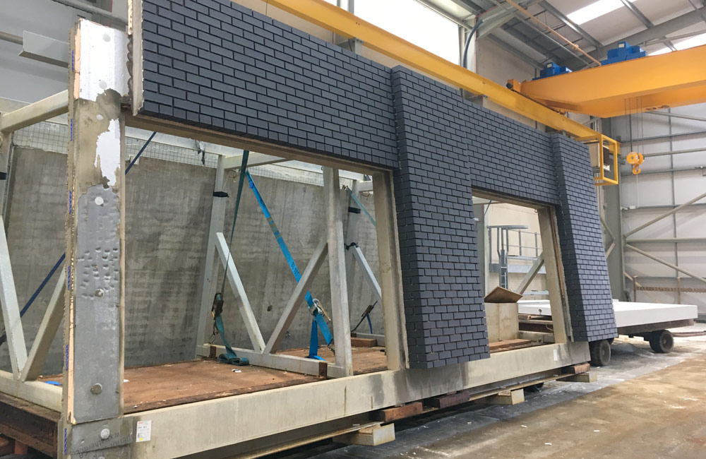 The structure is being built with concrete Crosswalls, PreFastCore and Architecturally finished brick faced sandwich panels