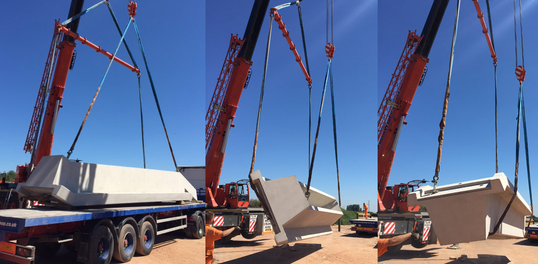 Precast stairwells being turned through 180 degrees for delivery and erection