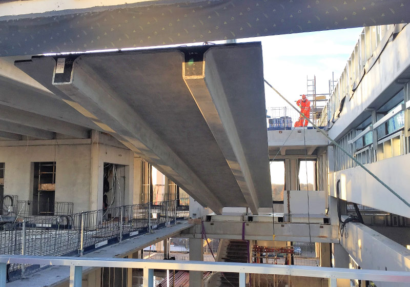 The 12.5 tonne Double Tee units have been lowered through the building using an adjustable Chain Block