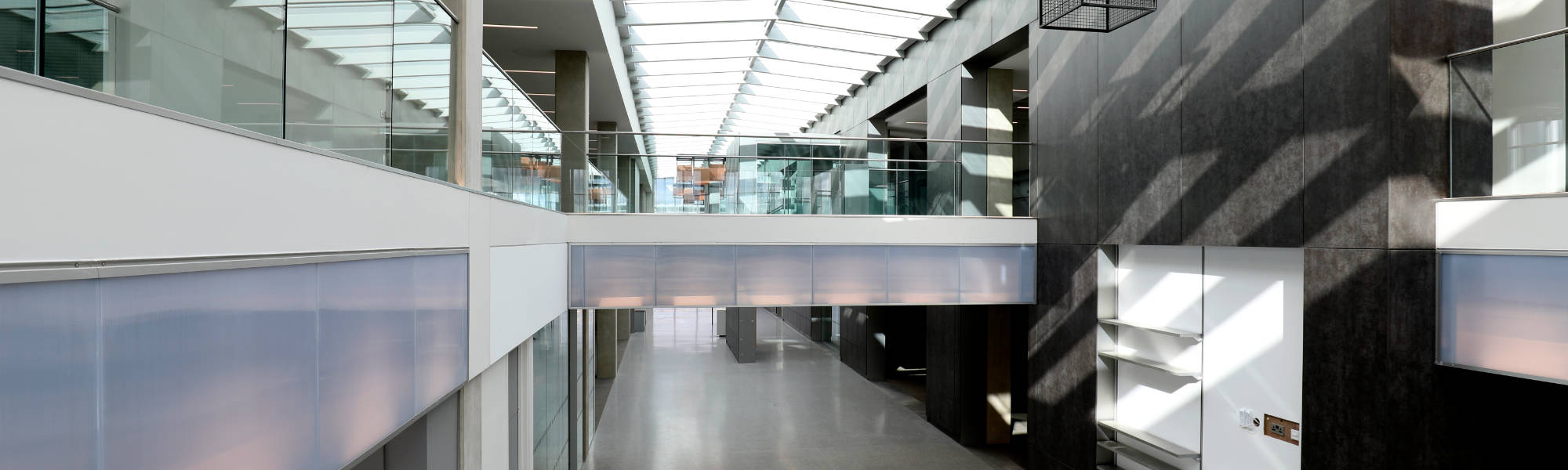 Internal exposed concrete surfaces, clear spans with the concrete units providing control of the building's internal environment