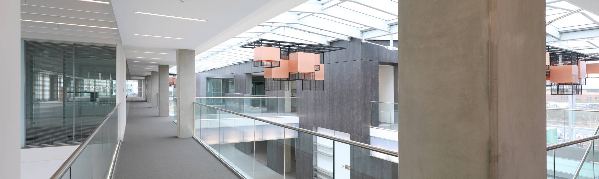 The first floor having two separate and distinct floor areas separated by an atrium area
