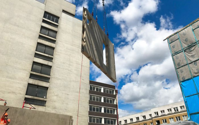 Offsite manufactured precast concrete unit being lifted into place