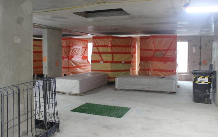 Lifting and loading out of bathroom pods and plasterboard onto the levels by PCE