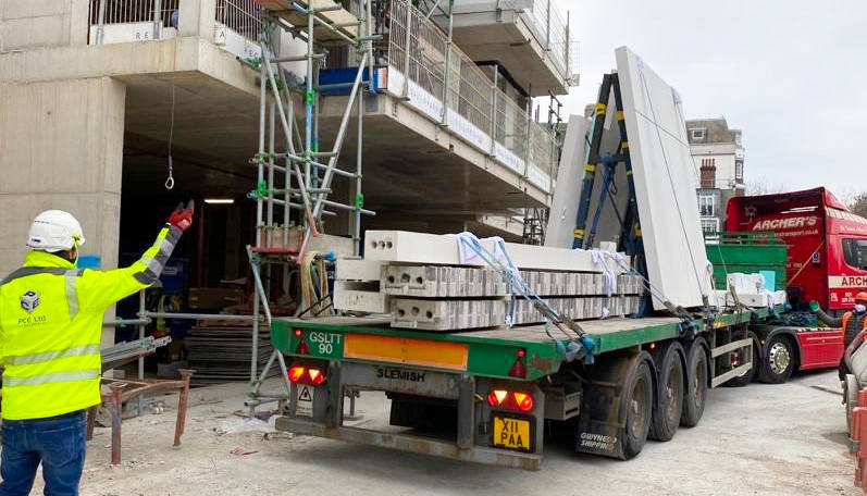 Delivery of reconstructed stone and brick-faced precast concrete cladding elements