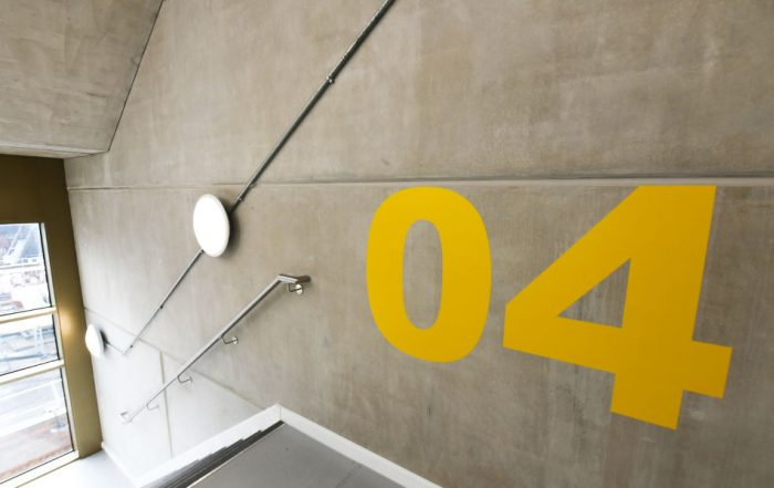 Exposed concrete to PCEs finished stair core