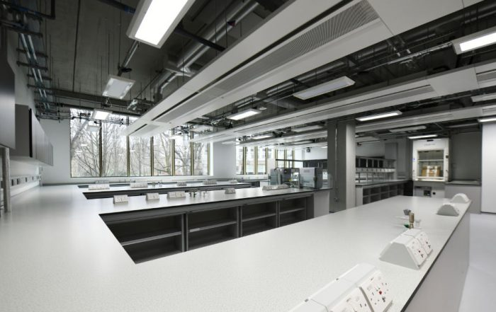 Exposed structural precast concrete columns and floor unit soffits within the laboratory spaces
